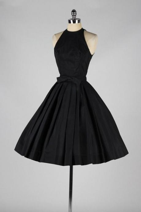 H1525 Black Halter Short Homecoming Dress Featuring Bow Accent Belt Featuring Open Back, Formal Dress